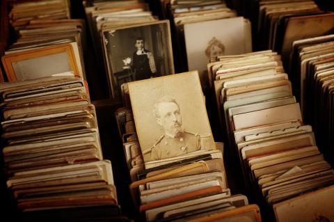 Old photos in a bin
