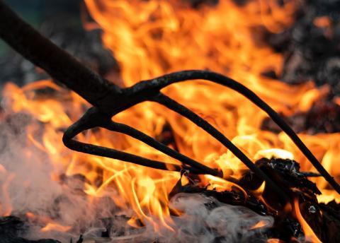 Pitch fork prodding fire